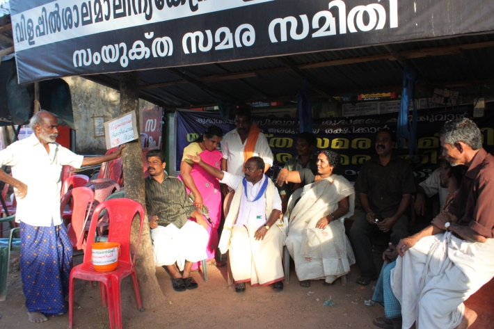 Members of the Vilappilsala panchayat (village council). To protest the garbage they've kept an ongoing hunger strike for over two years.