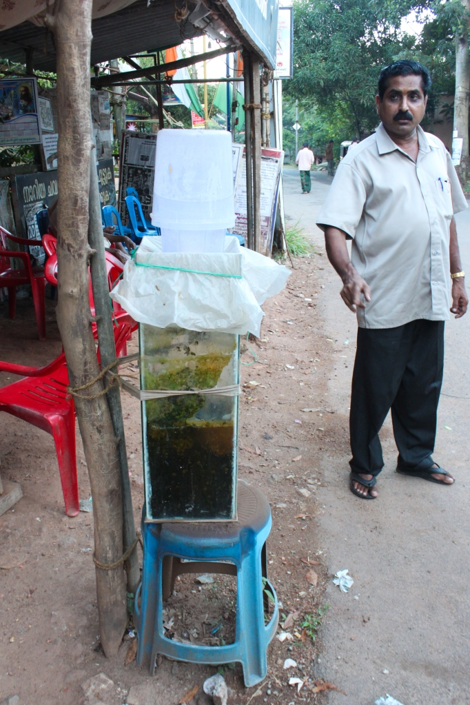 A Vilappilsala resident showcases leachate-polluted water from the river in Vilappilsala.