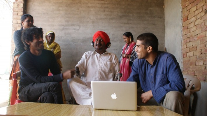 Taru Dalmia (left) with dalit musician and labor organizer Bant Singh (center).